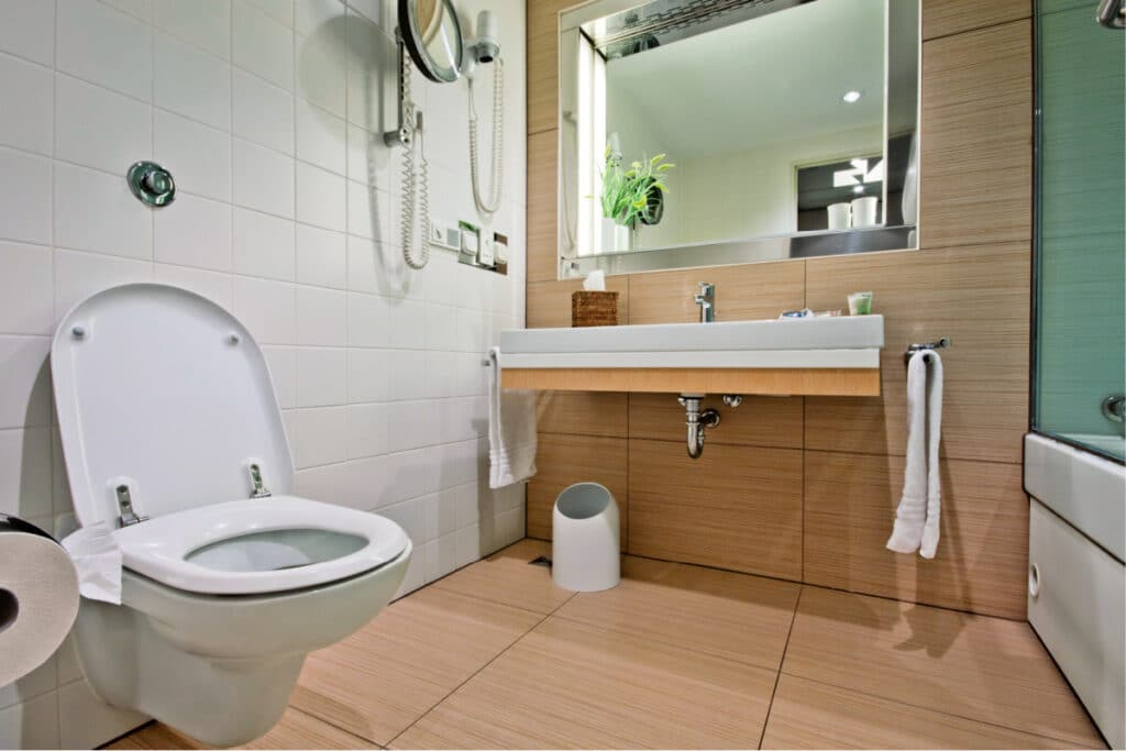 Modern bathroom with wall mounted toilet and sink