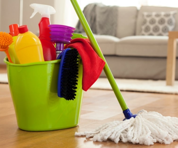 Closeup of mop and cleaning supplies in a bucket