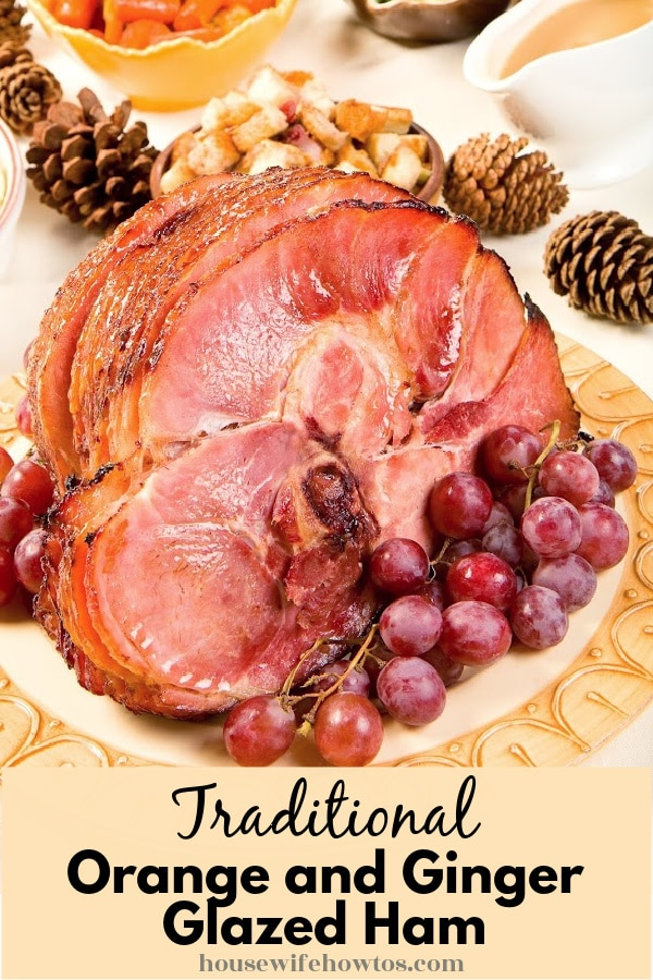 Image of a sliced ham served with vegetables on a platter and below is a caption that readers Traditional Orange and Ginger Glazed Ham