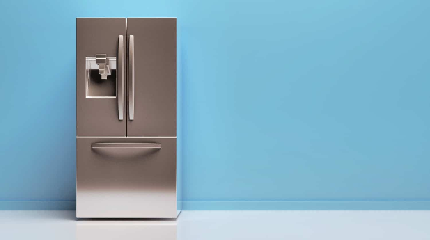 Clean and shiny stainless steel French door refrigerator sitting alone against a blank blue wall.