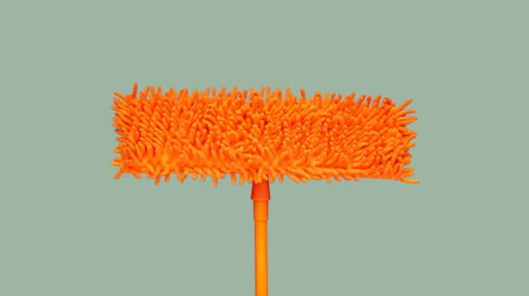 Closeup of orange microfiber mop used to clean baseboards without bending over