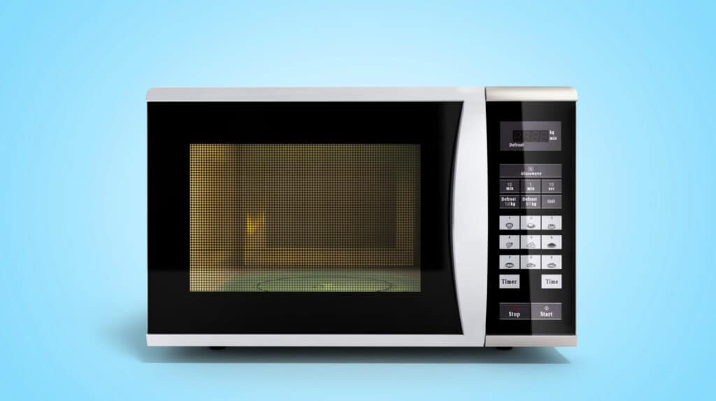 Clean microwave isolated against a blue background