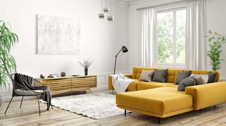 Modern living room with mustard yellow velvet sofa and black chair on wood flor