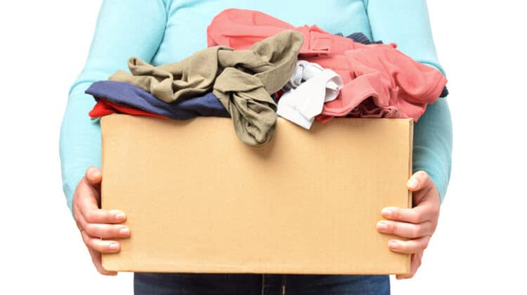 Person holding box of clothing to put in storage