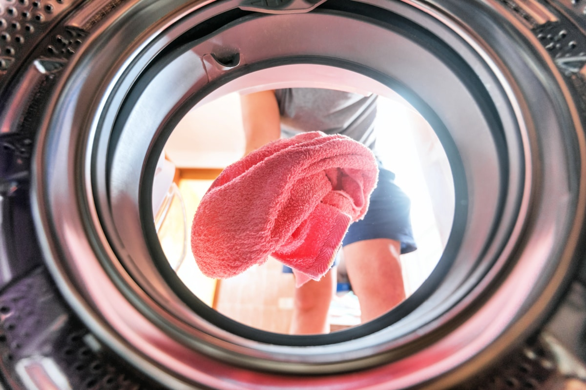 View from inside of dryer as someone puts towel in side