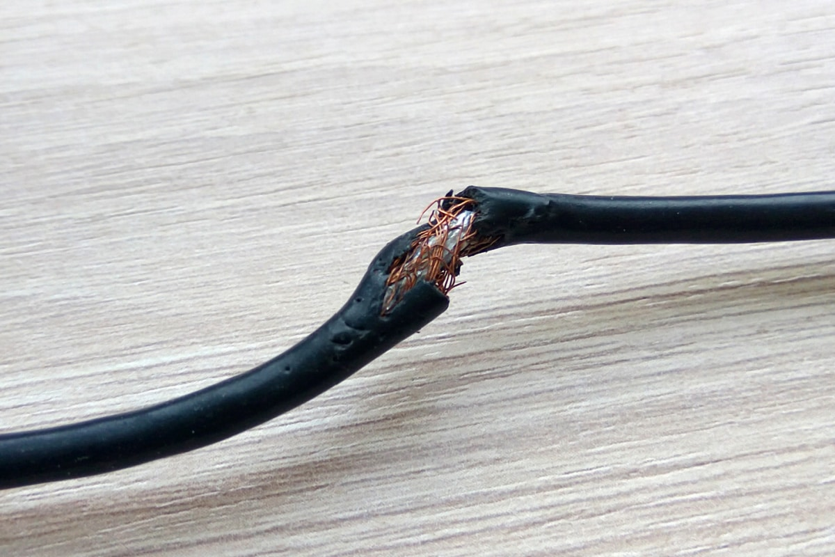 Electrical cord showing signs of rodent damage