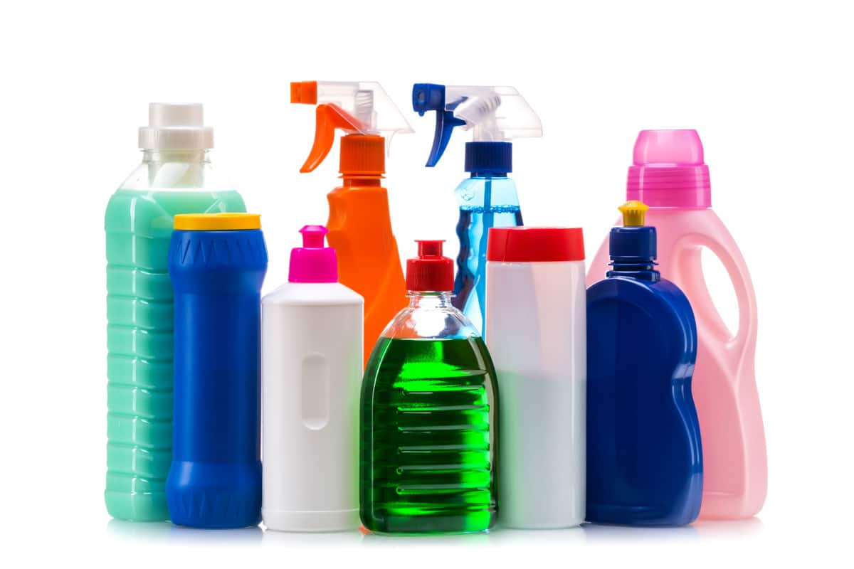 Cleaning products lined up against a blank background