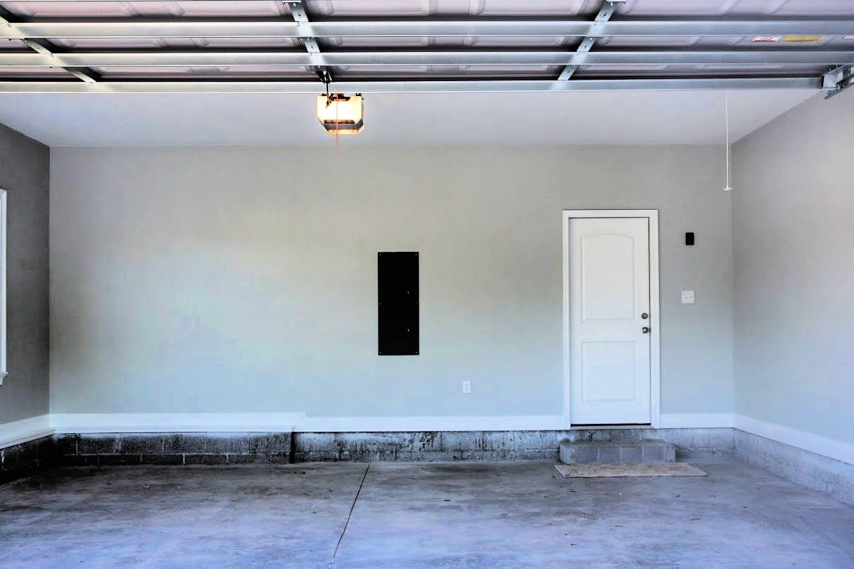 Photo of empty garage with stained concrete and cement floor