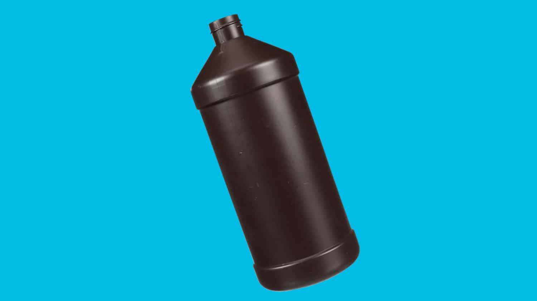 Bottle of hydrogen peroxide on a blue background