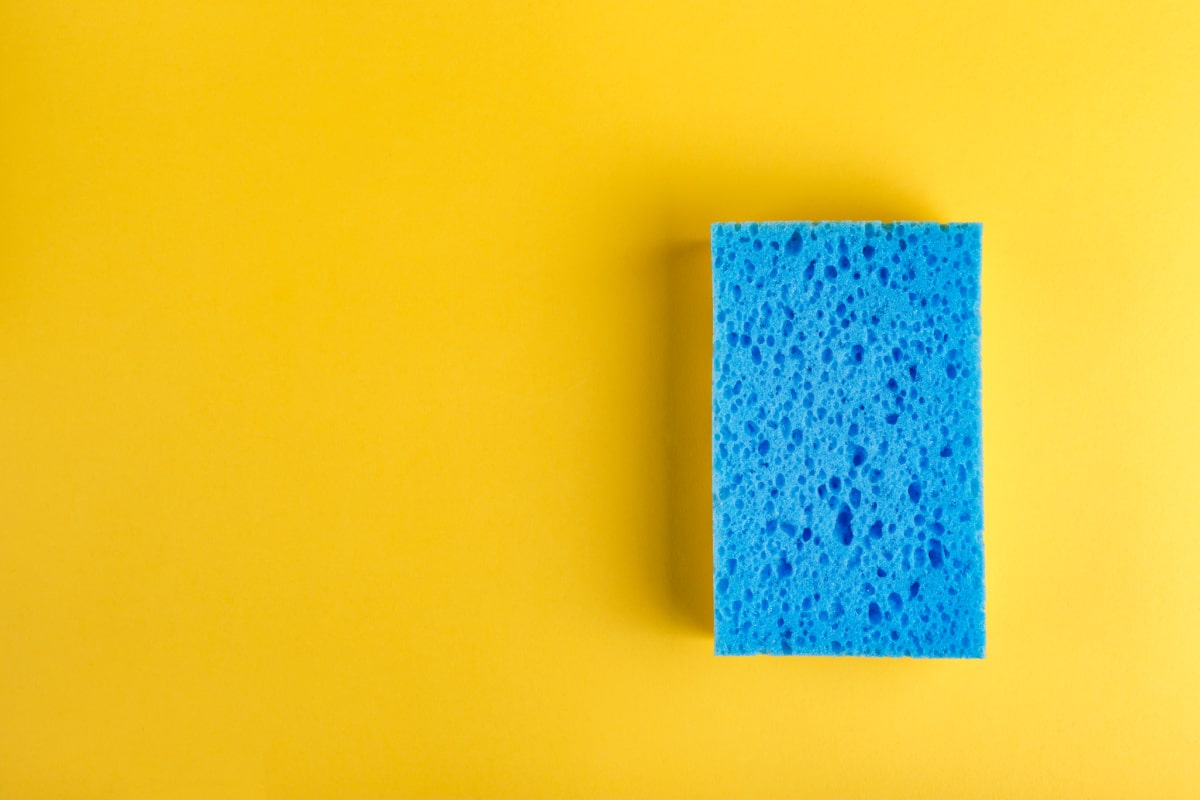 Overhead view of a blue kitchen sponge