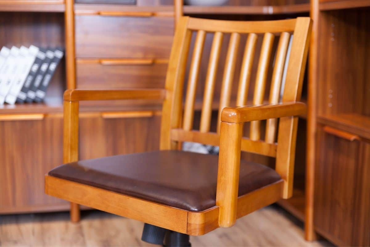 Closeup of wood swivel task chair in a home office