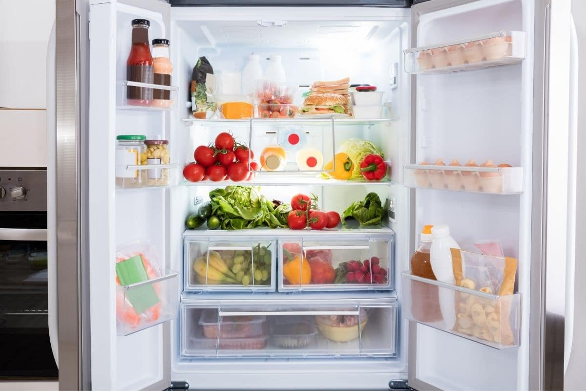 Contents of open fridge show best way to organize refrigerator