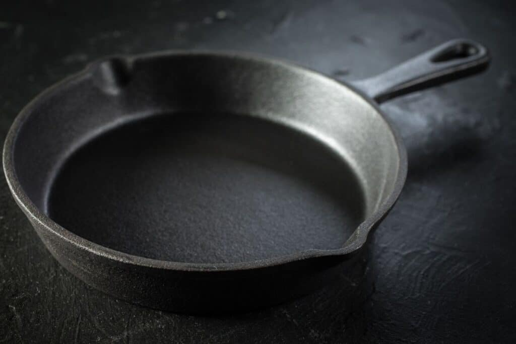 A perfectly seasoned cast iron pan after washing and stripping it to remove rust