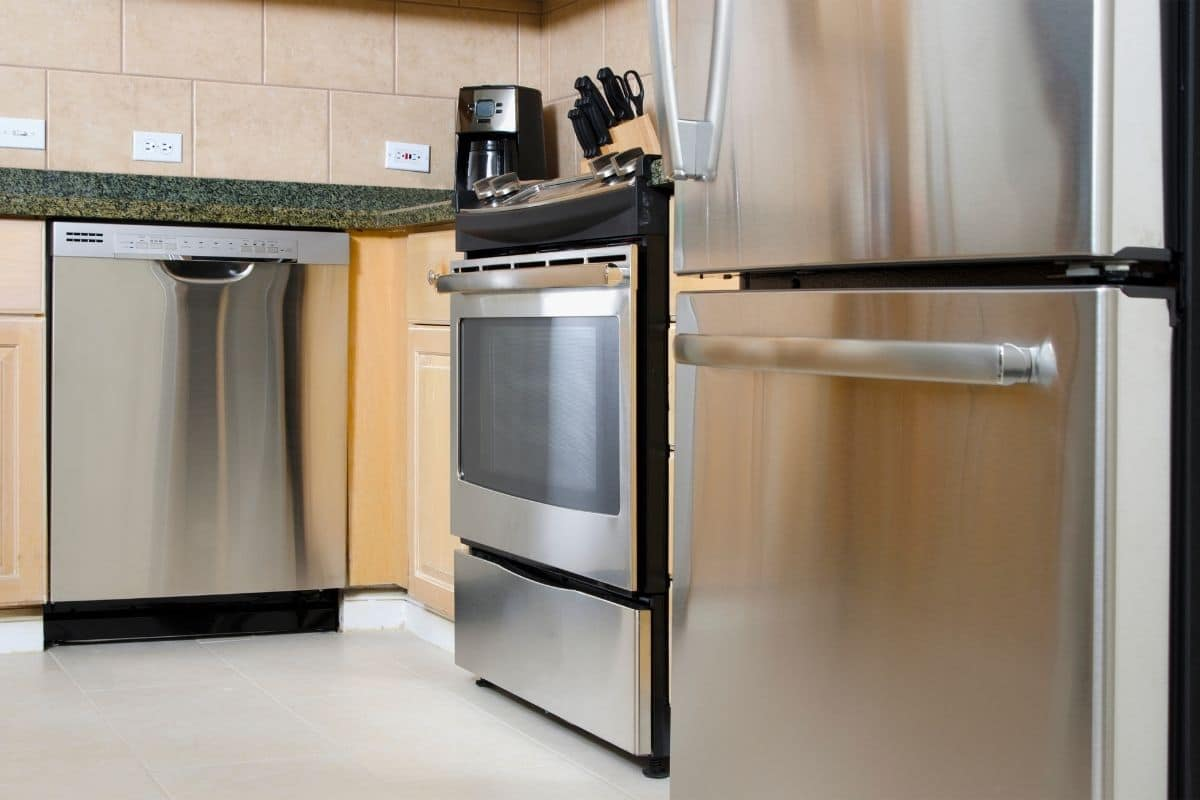 A clean kitchen with shiny, streak-free stainless steel appliances