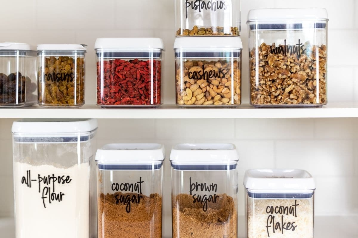 Clear square food storage containers with stylish labels are one of the best kitchen organizer tools