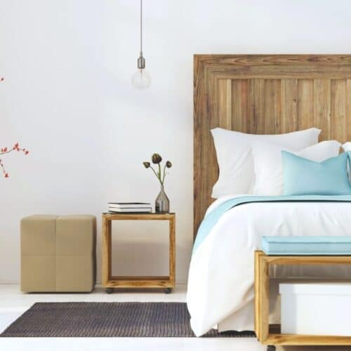 Modern bedroom with a queen-sized bed and several of the things that make a bedroom better